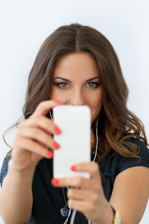 Selfie  Curly woman with mobile phone photo