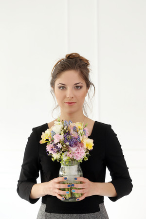 Cute, attractive woman with bouquet photo
