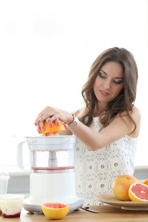 birthmark: Natural, vitamins  Cute, attractive woman making orange juice