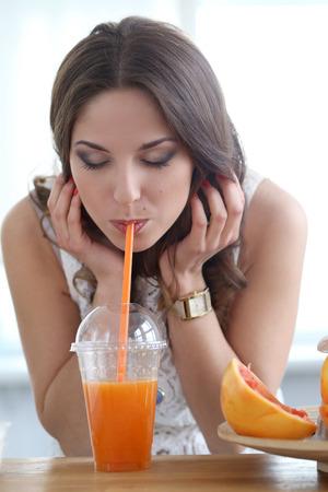 birthmark: Cute, attractive woman with orange juice