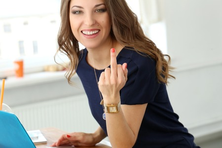 fuck: Cute, curly woman showing middle finger