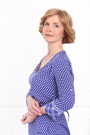 Cute, mature woman in dotted dress photo
