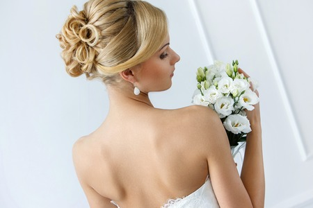 Wedding  Attractive bride with beautiful bouquet photo