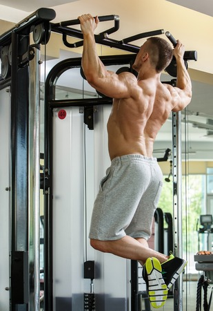 Fitness, bodybuilding  Powerful man during workout photo