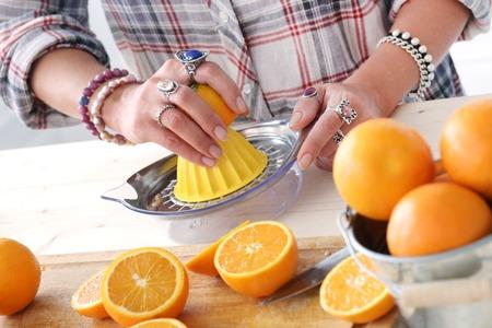 food woman: Food  Woman making orange juice Banque d'images