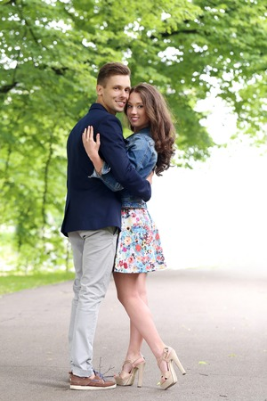 Cute, young couple in the park photo