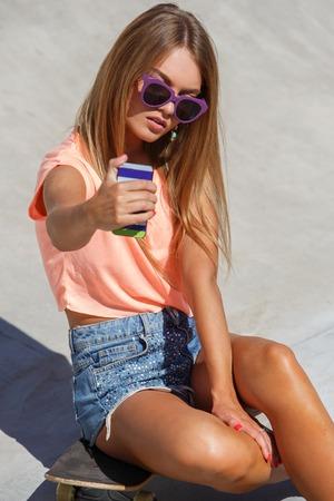 Outdoor, street  Attractive girl on the skateboard photo