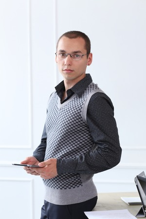 Office, employee  Successful, young man at work photo