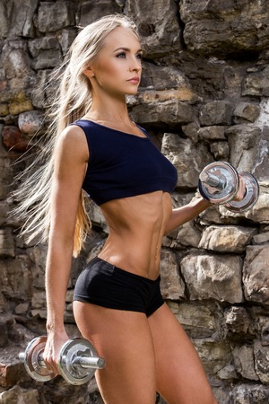Fitness, beauty  Sexy girl during workout