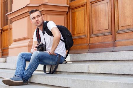 Tourist  Man during vacation trip photo