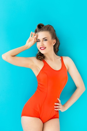 Pinup, summer  Attractive woman in red swimsuit photo