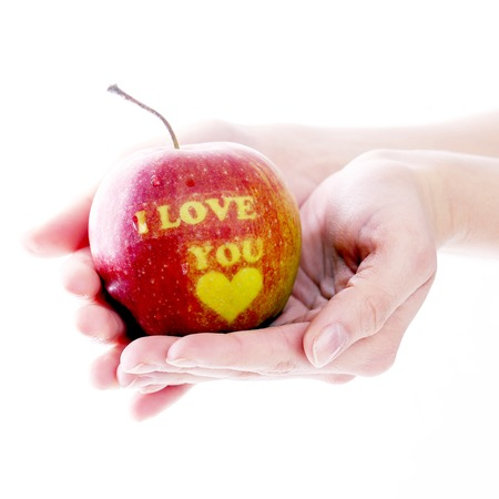 Gift, valentine  Man with delicious apple on a white background photo