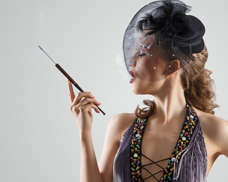 Burlesque  Cute, beautiful woman with cigarette photo