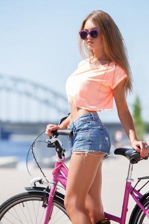 Outdoor, street  Attractive girl with bike