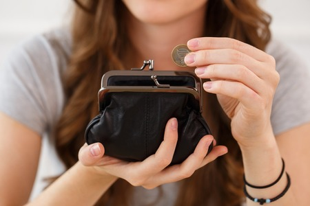 Money, coins  Woman with wallet photo