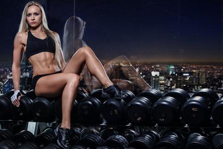 birthmark: Sport, bodybuilding  Attractive woman in the gym