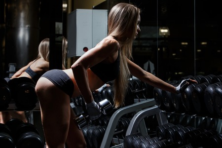 Sport, bodybuilding  Attractive woman in the gym photo
