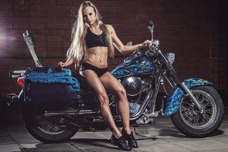 Bike  Sexy girl with perfect body photo