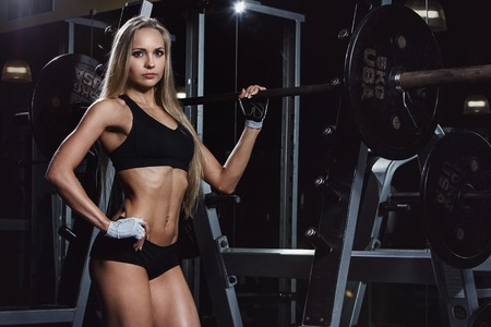 Sport, bodybuilding  Attractive woman in the gym