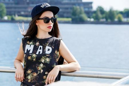 Street, outdoor  Attractive teen in a cap photo