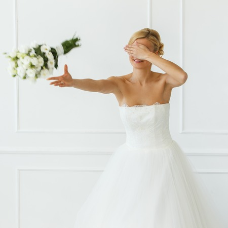 Wedding  Attractive bride throw beautiful bouquet