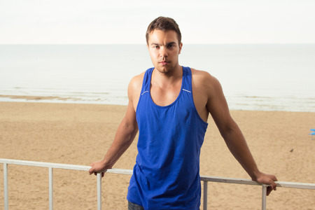 Lifeguard, summer  Handsome man on the beach photo
