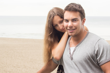 Summer, sea  Attractive couple on the beach photo