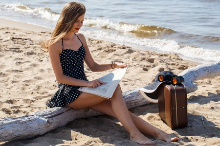 Beauty, summer  Cute, attractive woman on the beach photo