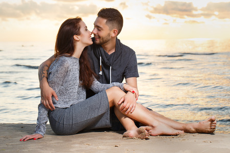 Summer, love. Attractive couple on the beach photo
