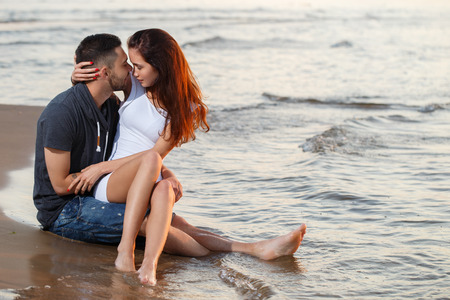 Summer, love. Attractive couple on the beach photo
