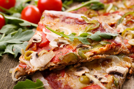 Food. Delicious pizza on the wooden table photo