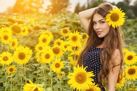 beauty woman: Cute girl in the field full of sunflowers