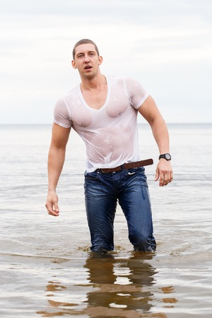 wet: Sport, fitness. Bodybuilder standing in the water