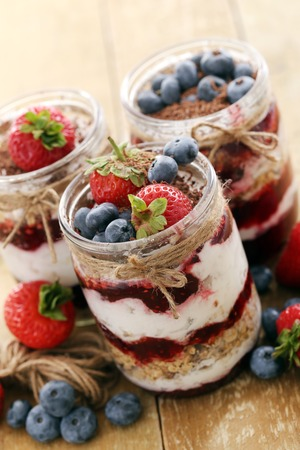breakfast food: Picture of jars with different berries