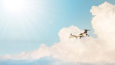 pilot light: Modern airplane flying in a cloudy sky