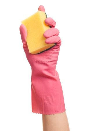 gloving up: Hand in a pink glove holding sponge isolated over white background
