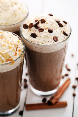 Closeup image of ice coffee with whipped cream and coffee beans photo