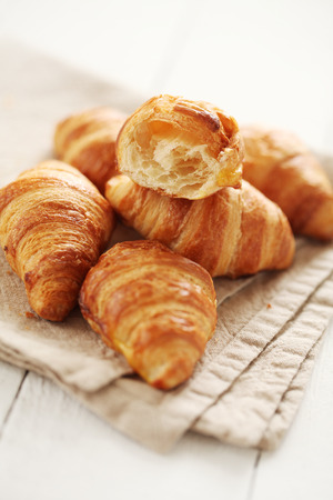 croissant: Fresh homemade french croissants on a linen tablecloth Stock Photo