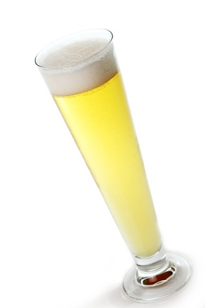 Fresh draft light beer in a glass isolated over white background photo