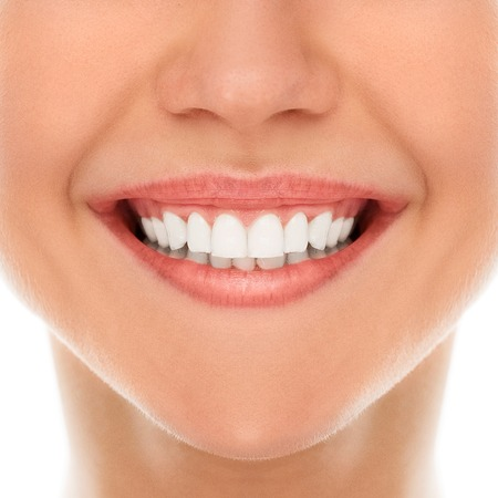 dentist woman: A woman is smiling while being at the dentist Stock Photo