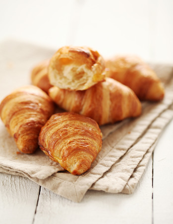 traditionally french: Fresh homemade french croissants on a linen tablecloth Stock Photo