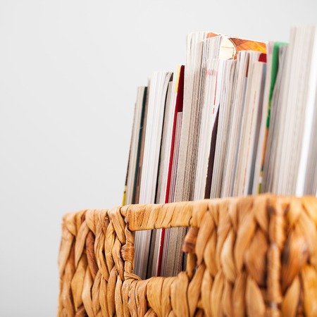 pleated: Closeup image of magazines in a straw pleated box Stock Photo