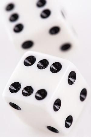 Rolling dice over a white background photo
