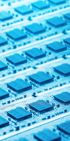 Closeup picture of computer parts in blue shining light photo