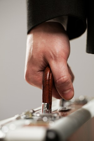 Exrensive document case in businessman hands photo