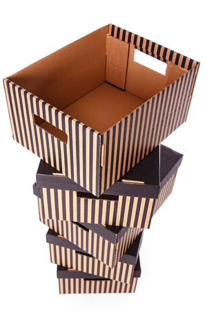 Package, delivery. Few striped boxes on a white background Reklamní fotografie