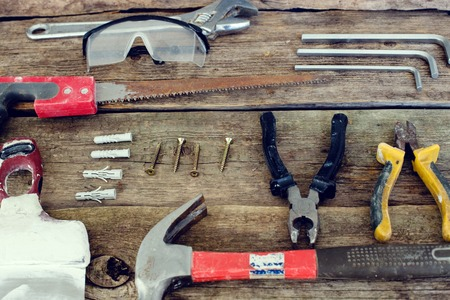 Workshop, repair. Tools on the wooden table photo