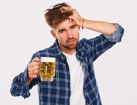 Alcohol, problems. Young alcoholic with beer photo