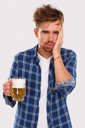 Young alcoholic with beer photo