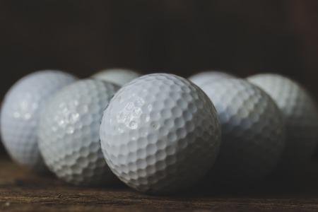 round collar: Few golf balls on the table Stock Photo